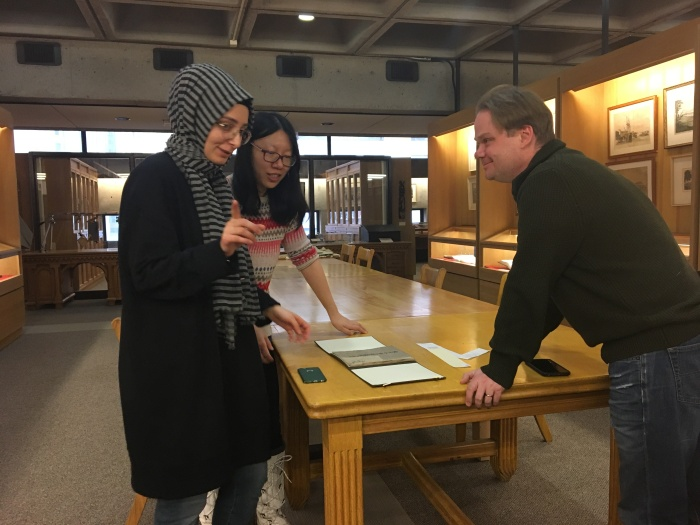 Prof. Bauer and SRS Graduate students visiting the Rare Book Collection (Photo courtesy of Jingjing LI)