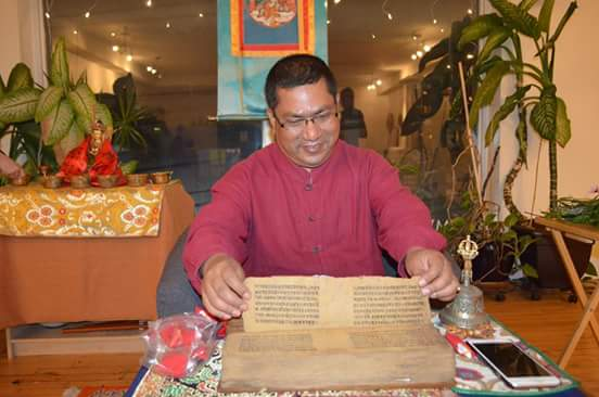 Professor Bajracharya displays his century old Sanskrit text after giving a lecture on dhāraṇīs.
